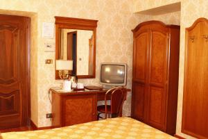 A television and/or entertainment center at Hotel Pace Helvezia