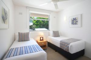 A bed or beds in a room at Maison Noosa