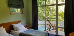 A bed or beds in a room at Nunisi Forest Hotel & SPA