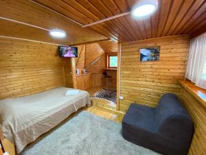 A bed or beds in a room at Holiday House Aveliya