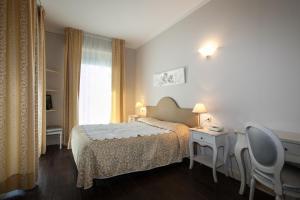 Een bed of bedden in een kamer bij Hotel Marconi