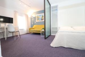 A bed or beds in a room at Miró Studio Apartments Dubrovnik