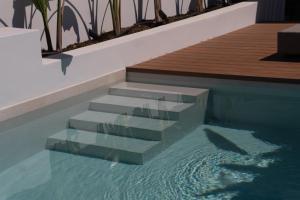 Der Swimmingpool an oder in der Nähe von Iperion Beach Hotel