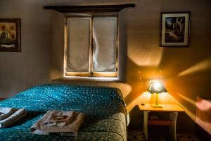Una cama o camas en una habitación de La Comarca del Jarillal