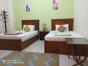 Cama o camas de una habitación en Golden Star Hostel