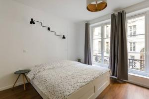 A bed or beds in a room at Rivoli
