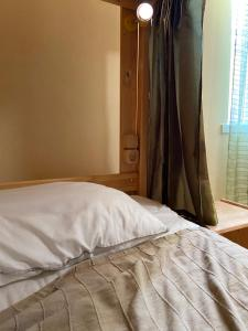 A bed or beds in a room at LIME