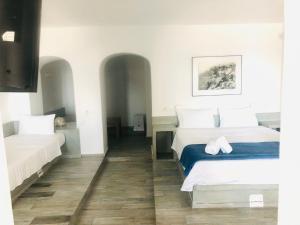 Un ou plusieurs lits dans un hébergement de l'établissement Loucas on the Cliff