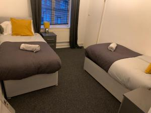 A bed or beds in a room at Eastfield Mews 3/4 beds upto 5 guests