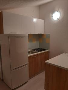 A kitchen or kitchenette at Apartments Cimbal