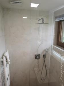 Koupelna v ubytování Ski&Bike Nassfeld Apartments