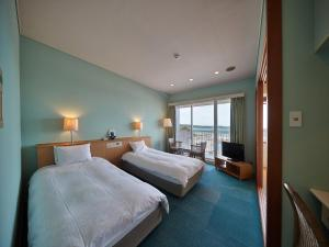 A bed or beds in a room at Ocean Resort PMC