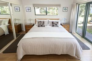A bed or beds in a room at Allegra House