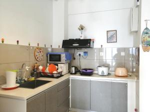 A kitchen or kitchenette at Woodsbury Butterworth Homestay Penang Sentral