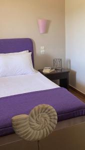 A bed or beds in a room at Diamond Palace