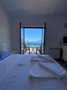 Кровать или кровати в номере Apartments Family