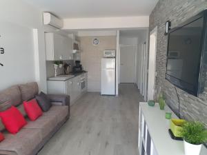 Una cocina o zona de cocina en Apartamento Primera Línea de Playa