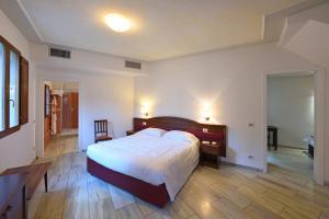 Cama o camas de una habitación en Relais La Corte di Cloris