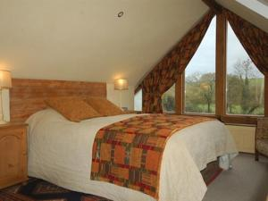A bed or beds in a room at The Old Forge