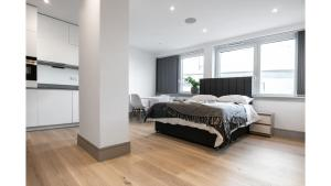 A bed or beds in a room at Finchley Modern Studio Apartments S