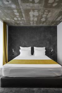 A bed or beds in a room at Adella Boutique Hotel