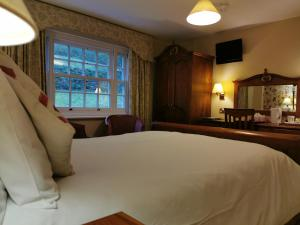 A bed or beds in a room at Rose in Vale Country House Hotel