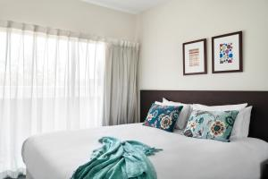 A bed or beds in a room at Punthill Essendon