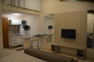 A television and/or entertainment centre at Lofts Asa Delta