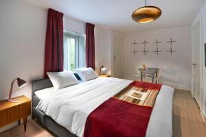 A bed or beds in a room at de Soete Moeder
