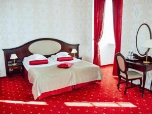Ein Bett oder Betten in einem Zimmer der Unterkunft Hotel Zamek Rydzyna
