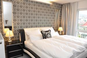 Ein Bett oder Betten in einem Zimmer der Unterkunft Villa Casamia - Übernachtung