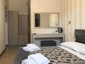 Letto o letti in una camera di Adelaide House