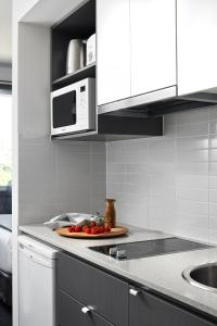 A kitchen or kitchenette at Punthill Oakleigh