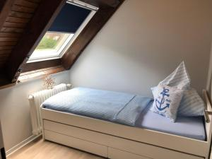 Ein Bett oder Betten in einem Zimmer der Unterkunft Noord Huus Ferienapartment
