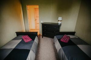 Gulta vai gultas numurā naktsmītnē Salas Holiday Home