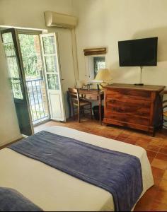 Un ou plusieurs lits dans un hébergement de l'établissement LE MAS DE FANNY