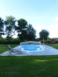 The swimming pool at or near Les Baillis