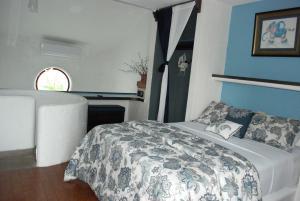 A bed or beds in a room at Hotel Villas Las Anclas