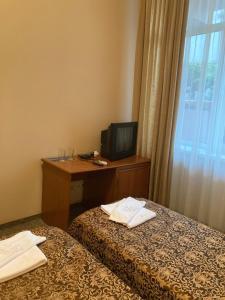 Кровать или кровати в номере Аллес, Лазаревское, Одоевского 65В