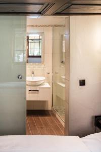 Ein Badezimmer in der Unterkunft Romantik Hotel Greifen-Post