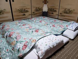 Homestay Michi Houseにあるベッド