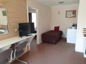 A television and/or entertainment center at Blayney Central Motel