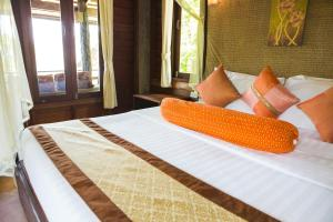 A bed or beds in a room at Sensi Paradise Beach Resort