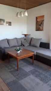 Ein Sitzbereich in der Unterkunft Mühlbachhof
