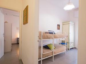 A bunk bed or bunk beds in a room at Locazione Turistica La casa della ceramista