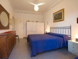 A bed or beds in a room at Locazione Turistica La casa della ceramista