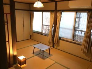 A seating area at Guest House Kyoto Shirakawa