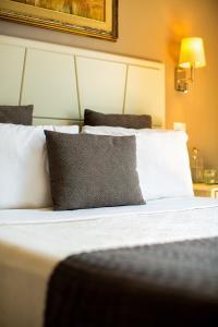 Letto o letti in una camera di Marlin Rooms