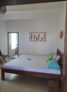 Un ou plusieurs lits dans un hébergement de l'établissement Jazzy Beach