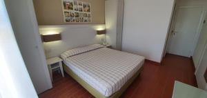 A bed or beds in a room at Hotel Mare